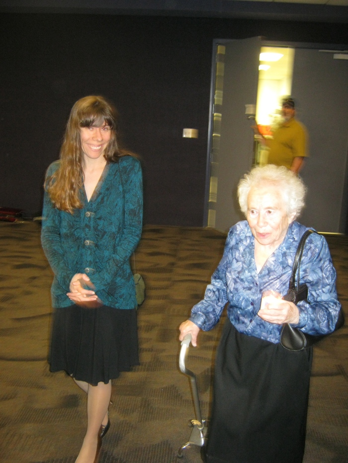 Holocaust survivor during the Tucson ceremony of lighting candles, accompanied by contemporary Jewish artist